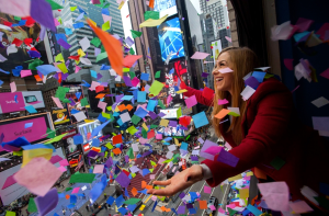 (From NBC's Photoblog) NYE host Allison Hagendorf conducts the confetti air-worthiness-test, from a Times Square office window on Saturday.