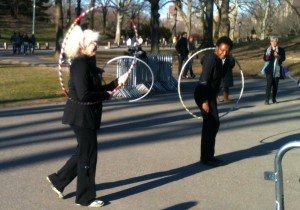 Music flow: Joan Warburton showed onlookers how to keep hoop maneuvers in time with the music.